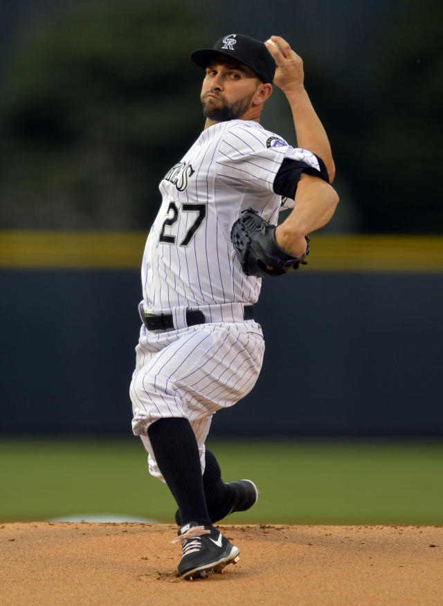 Colorado Rockies starting pitcher Tyler Chatwood throws to the plate against the Philadelphia Phillies during the first inning of a baseball game on Friday, April 18, 2014, in Denver. (AP Photo/Jack Dempsey)