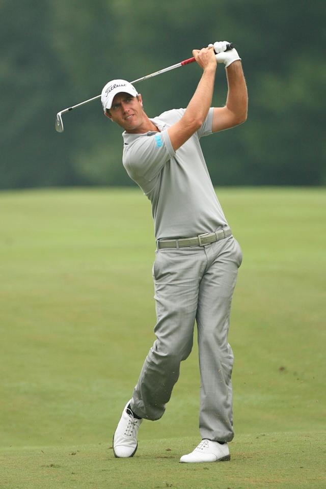 GREENSBORO, NC - AUGUST 20: Nicolas Colsaerts of Belgium hits his second shot on the 18th hole during the final round of the Wyndham Championship at Sedgefield Country Club on August 20, 2012 in Greensboro, North Carolina. (Photo by Hunter Martin/Getty Images)