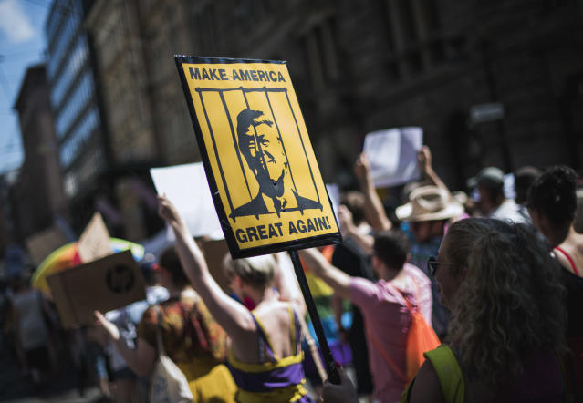 "<p>A protester holds a placard featuring President Donald Trump behinid bars during the so-called ""Helsinki Calling"" march towards the Senate Square to defend the human rights, freedom of speech and democracy on July 15, 2018, ahead of the arrival of President for a summit with his Russian counterpart in the Finnish capital Helsinki. (Photo: Jonathan Nackstrand/AFP/Getty Images) </p>"