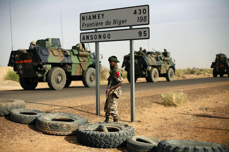 FILE - This Feb. 6, 2013, file photo shows French armoured vehicles heading towards the Niger border before making a left turn north in Gao, northern Mali. Promises of a pullout of France's 4,000 troops in Mali starting next month are looking harder and harder to fulfill. The fighting in rugged mountain terrain is growing tougher and threats of suicide bombings and hostage-takings are getting worse. (AP Photo/Jerome Delay, File)