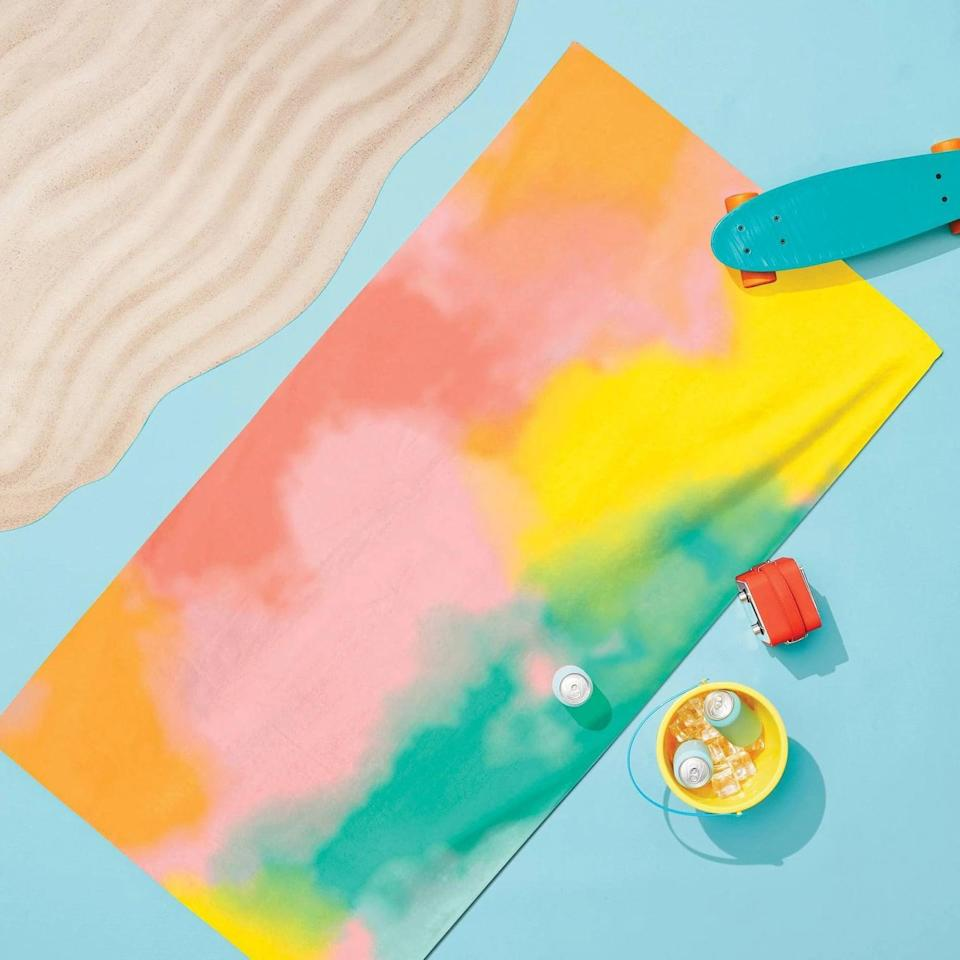 <p>Embrace the tie-dye trend with this bright and colorful <span>Sun Squad Tie Dye Printed Beach Towel</span> ($10).</p>