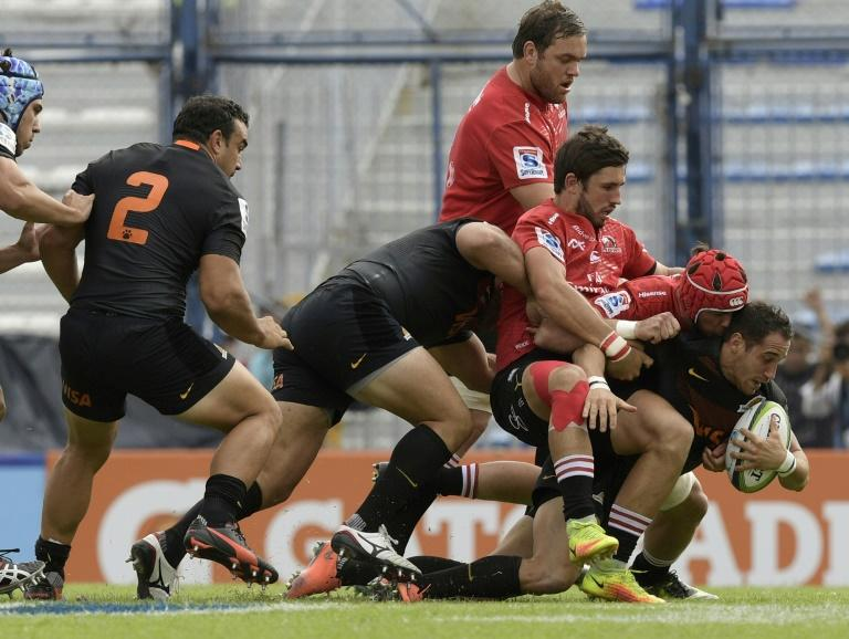 Argentina's Joaquin Tuculet (R) is tackled by South Africa's Warren Whiteley  (2-R) and Jacques Nel during their match in Buenos Aires on March 11, 2017