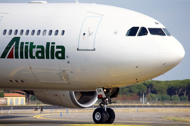 FILE PHOTO: An Alitalia airplane is seen before take off from the Leonardo da Vinci-Fiumicino Airport in Rome