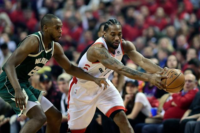 Kawhi Leonard was clearly hobbled in Game 4, but it didn't matter as the Raptors rolled. (AP)
