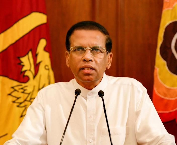 Sri Lanka's current president Maithripala Sirisena (pictured) challenged Mahinda Rajapakse in January after breaking away from their UPFA, but has returned to the party since his victory and taken over its leadership (AFP Photo/)