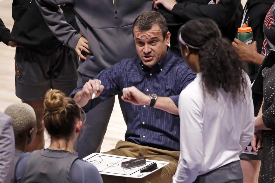 FILE - In this Sunday, Feb. 23, 2020, file photo, Louisville coach Jeff Walz gives instructions during a timeout during the first half of an NCAA college basketball game against Pittsburgh, in Pittsburgh. Walz's fifth-ranked Cardinals are picked to win the Atlantic Coast Conference race. (AP Photo/Gene J. Puskar, File)
