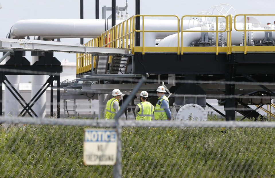 FILE - In this June 29, 2018, file photo, workers look over the Superior terminal of Enbridge Energy in Superior, Wis. The state of Minnesota has gone to federal court to block a lawsuit over Enbridge Energy's Line 3 oil pipeline project from proceeding in tribal court. (AP Photo/Jim Mone, File)