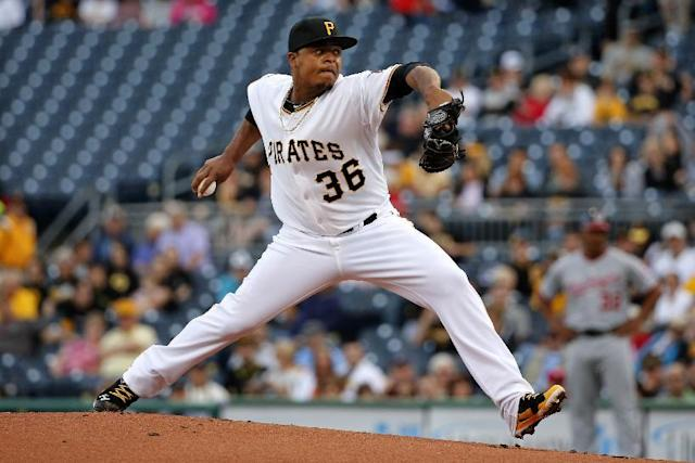 Pittsburgh Pirates' Edinson Volquez delivers during the first inning of a baseball game against the Washington Nationals in Pittsburgh Thursday, May 22, 2014. (AP Photo/Gene J. Puskar)