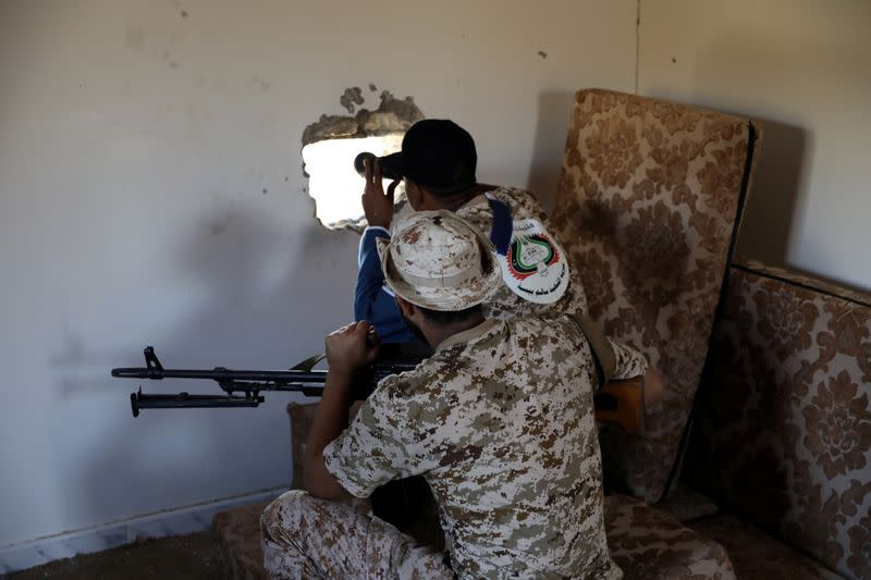 FILE PHOTO: Members of the Libyan internationally recognised government forces take their positions in Ain Zara