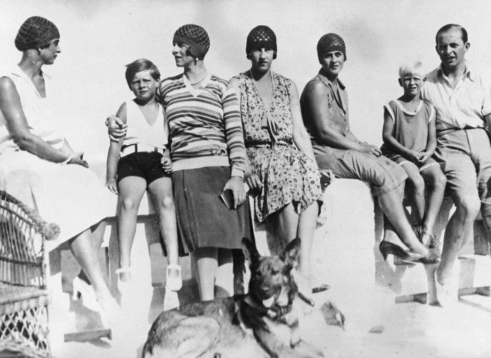FILE - In this Sept. 8, 1928 file photo, Romania's King Michael, second left, with his mother, Princess Helene, enjoy a holiday at Mamaia, Romania. From left, Princess Fedora of Greece, King Michael, Princess Helene, Princess Irene of Greece, Princess Marguerite of Greece, Prince Philip of Greece and Prince Paul of Greece. Prince Philip was born into the Greek royal family but spent almost all of his life as a pillar of the British one. His path was forged when he married the heir to the British throne, and a promising naval career was cut short when his wife suddenly became Queen Elizabeth II. Nevertheless, he set about forging a place for himself as royal consort. He was a patron of charities and a supporter of projects for young people. He was married for more than 73 years and was still carrying out royal engagements into his late 90s. (AP Photo/File)