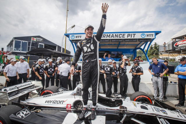 Simon Pagenaud of France celebrates after winning first pole position during qualifying at the 2019 Honda Indy Toronto, in Toronto, Saturday July 13, 2019. (Mark Blinch/The Canadian Press via AP)