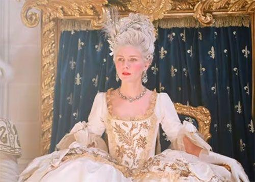 <p>Kirsten Dunst's wardrobe perfectly captured the lavish lifestyle of French royalty in <em>Marie Antoinette</em>. She shone in this elegant ensemble, which included a diamond scroll motif necklace and chandelier earrings. </p>