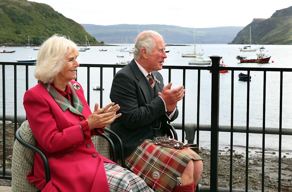 The Prince of Wales and Duchess of Cornwall, known as the Duke and Duchess of Rothesay when in Scotland, clap after being entertained by Gaelic singer, Robert Robertson, during their visit to Portree, in the Isle of Skye, in the Highlands of Scotland, to see how businesses are moving forward following the coronavirus lockdown. Picture date: Thursday September 16, 2021.