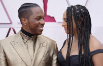 Leslie Odom Jr., left, and Nicolette Robinson arrive at the Oscars on Sunday, April 25, 2021, at Union Station in Los Angeles. (AP Photo/Chris Pizzello, Pool)