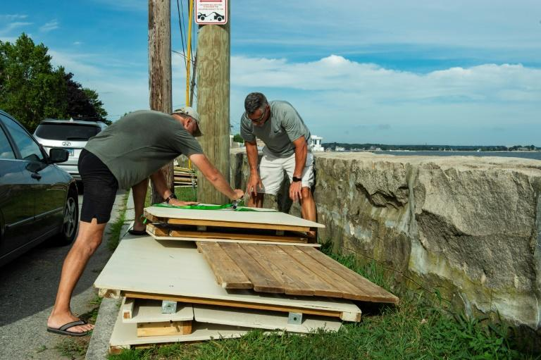 Members of a private beach association for Guthrie Beach tie down and disassemble beach huts prior to the arrival of Hurricane Henri in New London, Connecticut on August 21, 2021