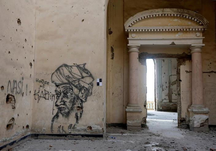 <p>Graffiti is seen on a wall of Darul Aman Palace in Kabul, Afghanistan, June 5, 2016. (Omar Sobhani/Reuters) </p>
