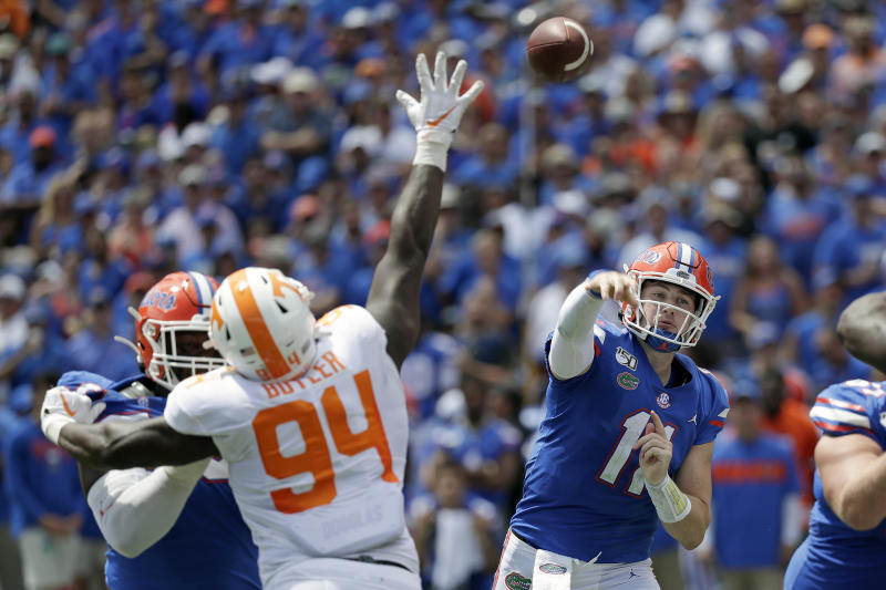 Florida quarterback Kyle Trask, right, throws a pass over Tennessee defensive lineman Matthew Butler (94) during the first half of an NCAA college football game, Saturday, Sept. 21, 2019, in Gainesville, Fla. (AP Photo/John Raoux)