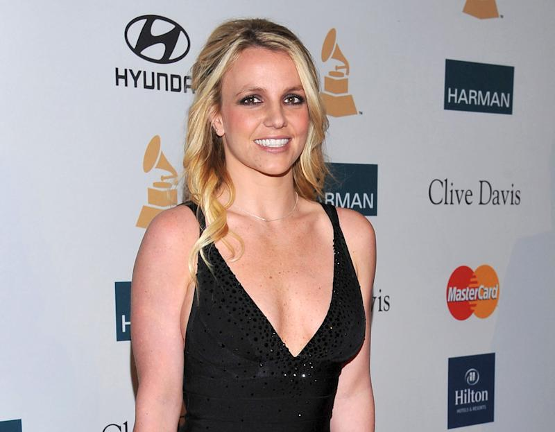 FILE - In this Feb. 11, 2012 file photo, singer Britney Spears arrives at the Pre-GRAMMY Gala & Salute to Industry Icons with Clive Davis honoring Richard Branson in Beverly Hills, Calif.  Jurors were selected in a case against the singer's parents and conservators with opening statements expected to begin Thursday Oct. 18, 2012, in Los Angeles. (AP Photo/Vince Bucci, file)