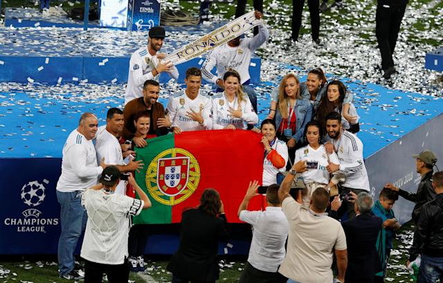 Soccer Football - Champions League Final - Real Madrid v Liverpool - NSC Olympic Stadium, Kiev, Ukraine - May 26, 2018 Real Madrid's Cristiano Ronaldo celebrates with his mother Maria Dolores dos Santos Aveiro, girlfriend Georgina Rodríguez, his son and family as they pose after winning the Champions League REUTERS/Phil Noble