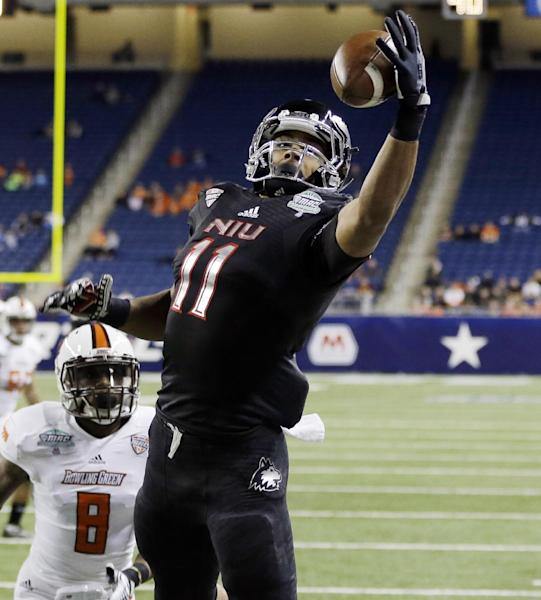 Northern Illinois wide receiver Juwan Brescacin (11) reaches for a 14-yard reception for a touchdown during the first quarter of an NCAA college football game against Bowling Green at the Mid-American Conference championship in Detroit, Friday, Dec. 6, 2013. (AP Photo/Carlos Osorio)