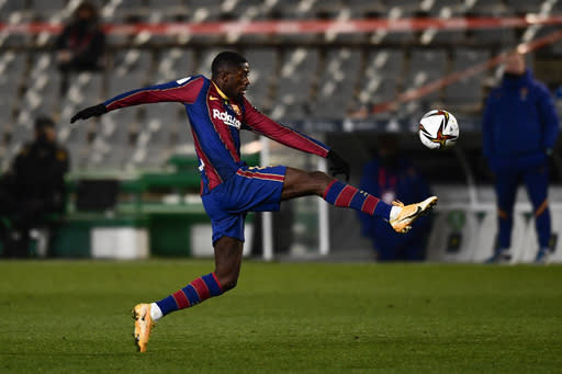 Barcelona's Ousmane Dembele lunges for the ball during Spanish Super Cup semi final soccer match between Barcelona and Real Sociedad at Nuevo Arcangel stadium in Cordoba, Spain, Wednesday, Jan. 13, 2021. (AP Photo/Jose Breton)