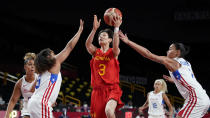 China's Liwei Yang (3) drives between Puerto Rico's Jennifer O'Neill, left, and Tayra Melendez, right, during a women's basketball preliminary round game at the 2020 Summer Olympics in Saitama, Japan, Tuesday, July 27, 2021. (AP Photo/Charlie Neibergall)