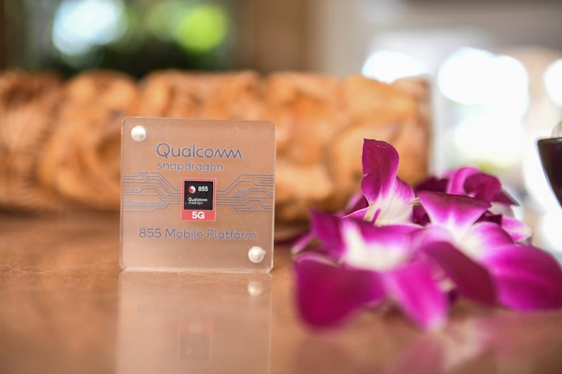 A Snapdragon 855 chip next to flowers.