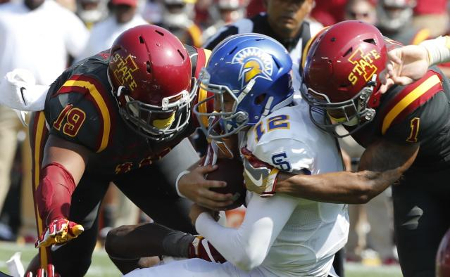 "AMES, IA Ð SEPTEMBER 24: Quarterback Josh Love #12 of the <a class=""link rapid-noclick-resp"" href=""/ncaab/teams/sag/"" data-ylk=""slk:San Jose State Spartans"">San Jose State Spartans</a> is sacked by defensive end <a class=""link rapid-noclick-resp"" href=""/ncaaf/players/271440/"" data-ylk=""slk:JaQuan Bailey"">JaQuan Bailey</a> #19, and defensive back D'Andre Payne #1 of the <a class=""link rapid-noclick-resp"" href=""/ncaab/teams/iao/"" data-ylk=""slk:Iowa State Cyclones"">Iowa State Cyclones</a>. (Photo by David Purdy/Getty Images)"