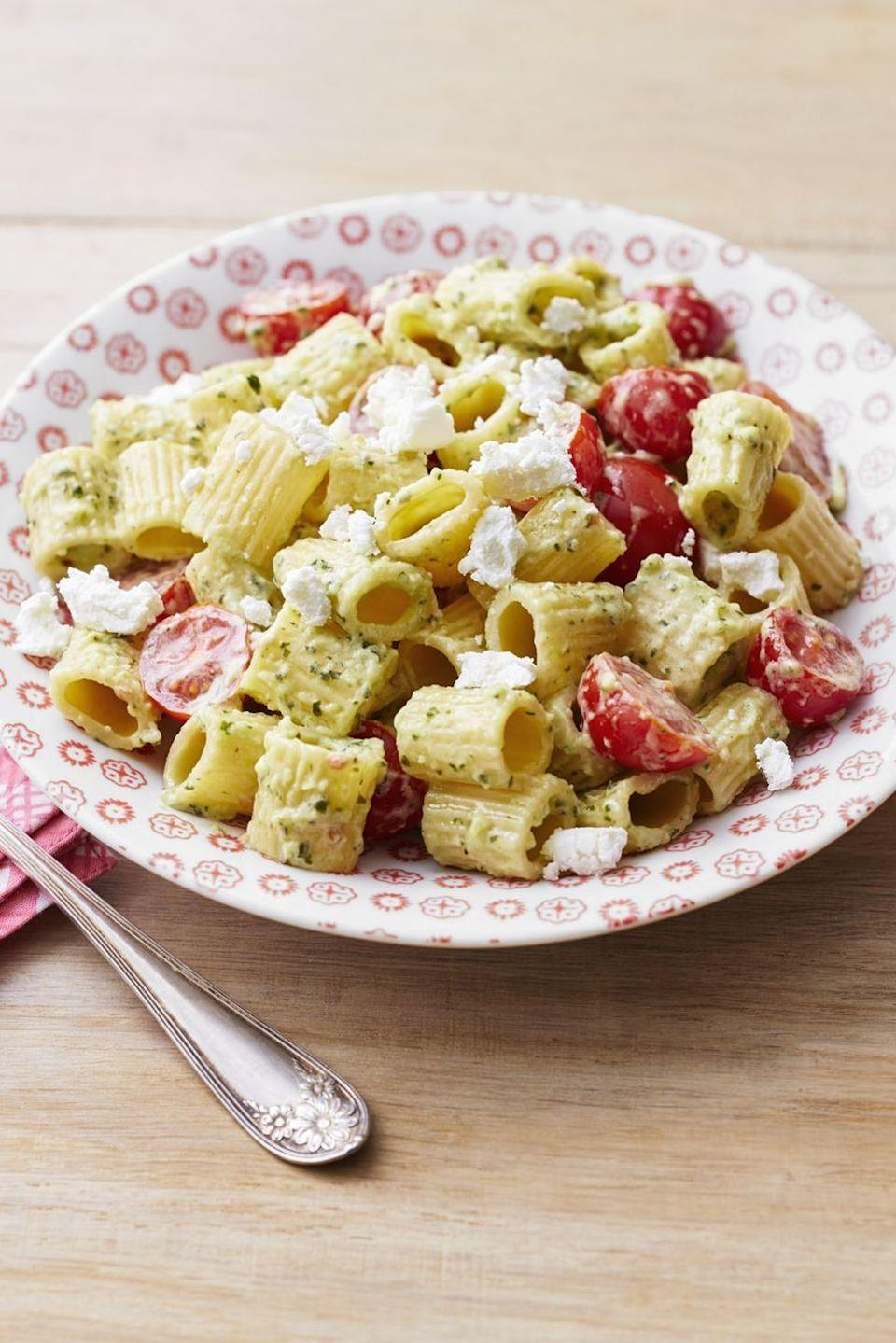 """<p>Make your own pesto cream sauce and toss it with rigatoni, cherry tomatoes, and goat cheese crumbles.</p><p><a href=""""https://www.thepioneerwoman.com/food-cooking/recipes/a32378514/rigatoni-with-pesto-cream-sauce-recipe/"""" rel=""""nofollow noopener"""" target=""""_blank"""" data-ylk=""""slk:Get the recipe."""" class=""""link rapid-noclick-resp""""><strong>Get the recipe.</strong></a></p>"""