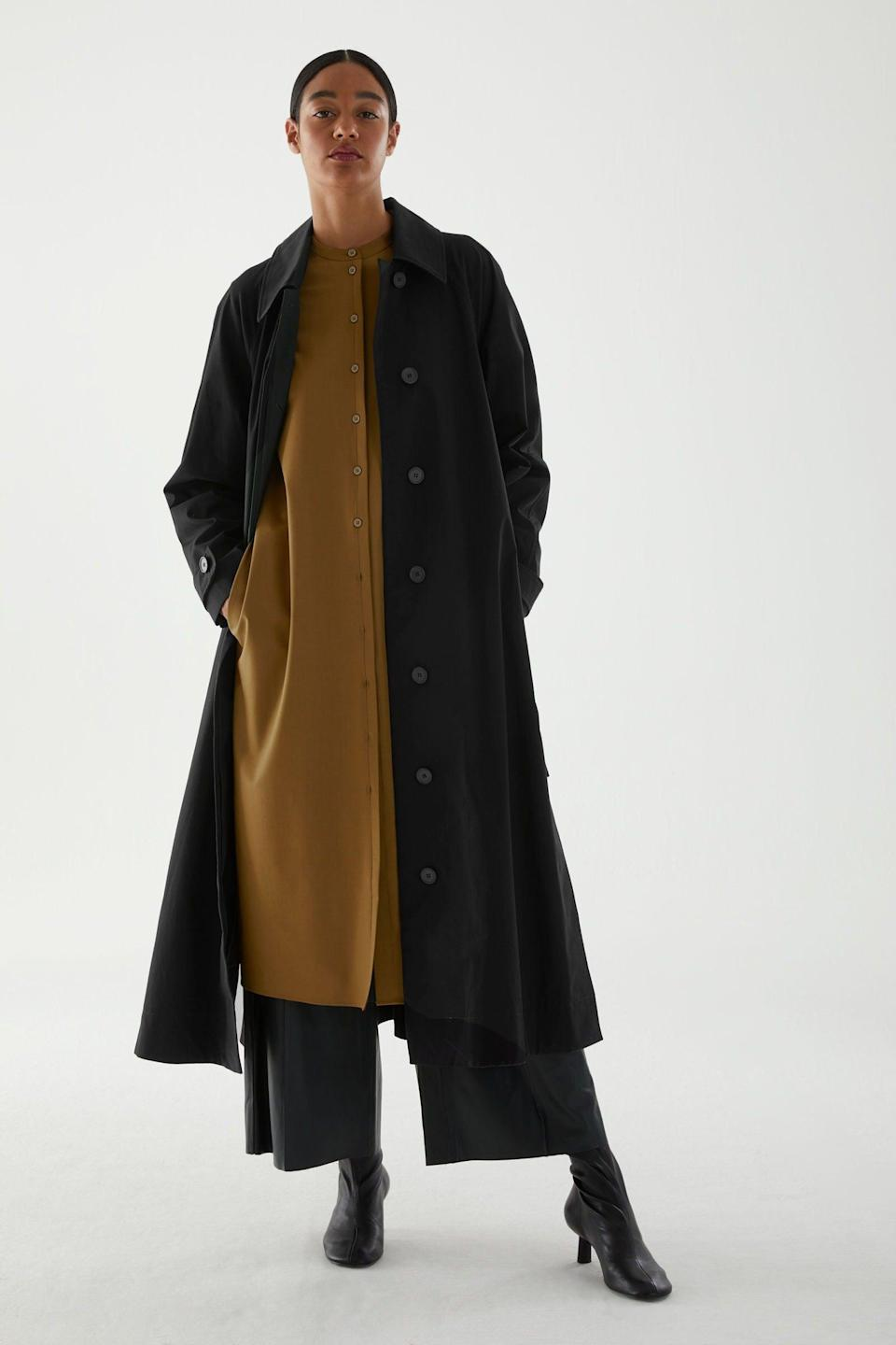 """<br><br><strong>COS</strong> Organic Cotton Oversized Trench, $, available at <a href=""""https://www.cosstores.com/en_gbp/women/womenswear/coats-and-jackets/coats/product.organic-cotton-oversized-trench-coat-black.0891555002.html?"""" rel=""""nofollow noopener"""" target=""""_blank"""" data-ylk=""""slk:COS"""" class=""""link rapid-noclick-resp"""">COS</a>"""