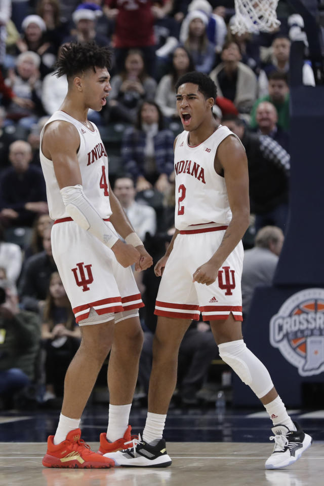 Indiana's Armaan Franklin (2) celebrates with Trayce Jackson-Davis (4) after Franklin hit the game winning shot during the second half of an NCAA college basketball game against Notre Dame, Saturday, Dec. 21, 2019. Indiana won 62-60 (AP Photo/Darron Cummings)