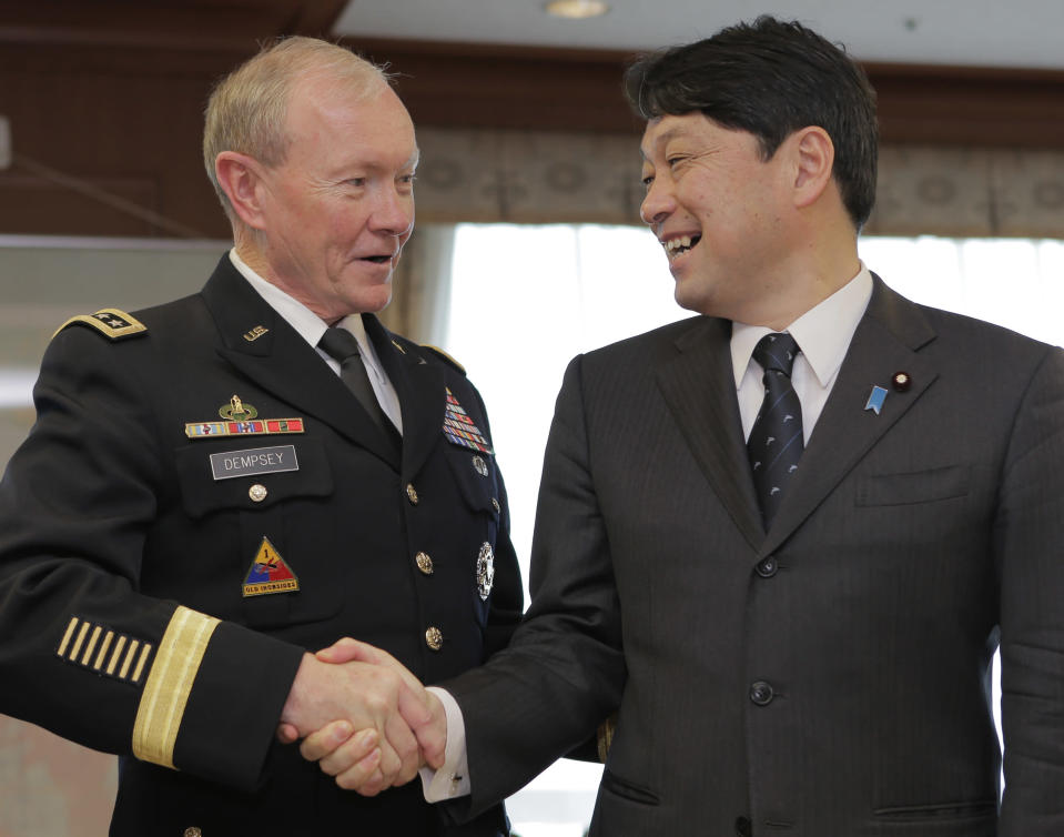 FILE - In this April 26, 2013 photo, Gen. Martin Dempsey, left, chairman of the U.S. Joint Chiefs of Staff, shakes hands with Japanese Defense Minister Itsunori Onodera prior to their meeting at Defense Ministry in Tokyo. Japanese troops will converge on California's southern coast in the next two weeks, the middle of June 2013, as part of a military exercise with U.S. troops aimed at improving that country's amphibious attack abilities. (AP Photo/Itsuo Inouye, File)