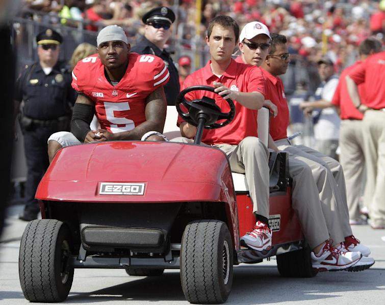 Ohio State quarterback Braxton Miller, left, is carted off the field after being injured during the first quarter against San Diego State in an NCAA college football game Saturday, Sept. 7, 2013, in Columbus, Ohio. (AP Photo/Jay LaPrete)