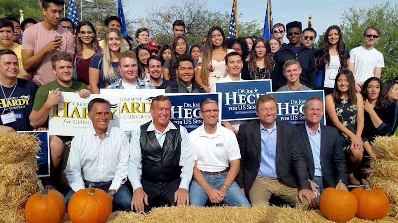 From left, Mitt Romney, Rep. Cresent Hardy, Rep. Joe Heck, Sen. Dean Heller and Nevada Lt. Gov. Mark Hutchison, posing with campaign volunteers at a rally in Las Vegas on Saturday, all say they can't support Donald Trump. (Photo: Michelle Rindels/AP)
