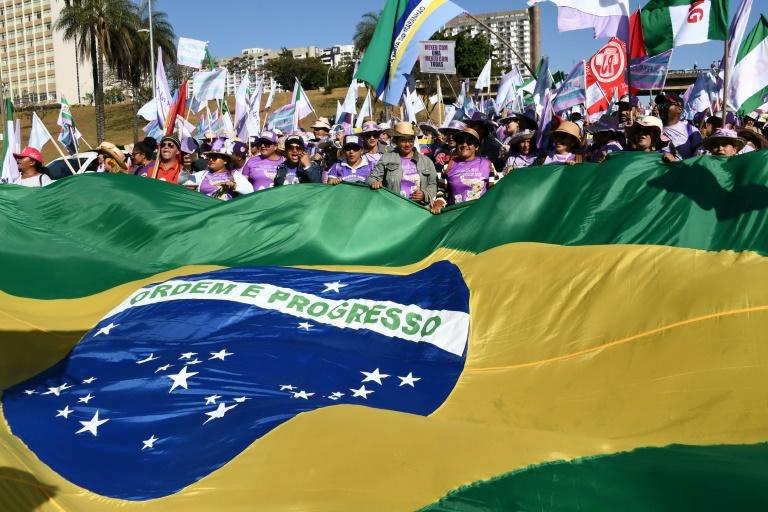 Women march against Brazilian President Jair Bolsonaro in the capital Brasilia
