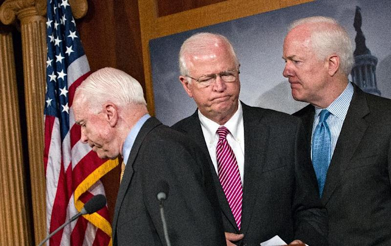 """FILE - This June 26, 2012 file photo shows, from left, Sen. John McCain, R-Ariz., Sen. Saxby Chambliss, R-Ga., vice chair of the Senate Intelligence Committee, and Sen. John Cornyn, R-Texas, during a news conference on Capitol Hill in Washington. Chambliss announced Friday, Jan. 25, 2013, he will not seek a third term next year, saying """"this is about frustration"""" with Washington gridlock that he doesn't see changing in a divided government. (AP Photo/J. Scott Applewhite, File)"""