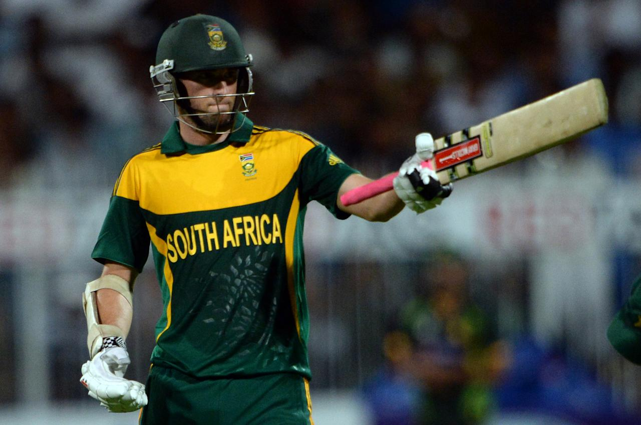 South African cricketer Wayne Parnell wave his bat after making fifty runs during the first one-day in Sharjah Cricket Stadium in Sharjah on October 30, 2013. South African captain AB de Villiers won the toss and decided to bat in the first of five one-day internationals against Pakistan in Sharjah. AFP PHOTO/ ASIF HASSAN        (Photo credit should read ASIF HASSAN/AFP/Getty Images)