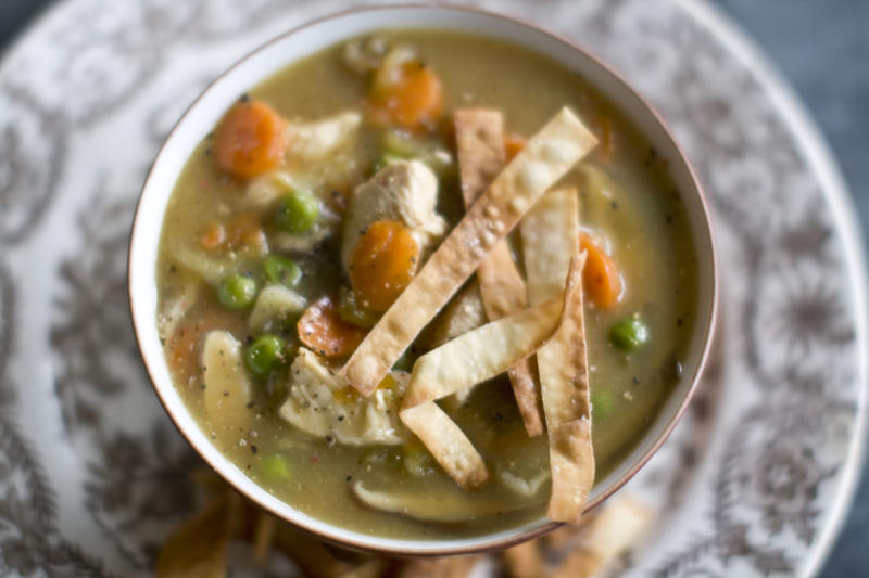 This Dec. 2, 2013 photo shows Chinese chicken and vegetable soup in Concord, N.H. This recipe's fragrant broth is essentially a Chinese version of a Jewish chicken soup. (AP Photo/Matthew Mead)