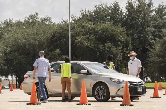Voters will cast a ballot by mail at the drive-through polling place in Houston on October 23, 2020.  (Go Nakamura / The New York Times)