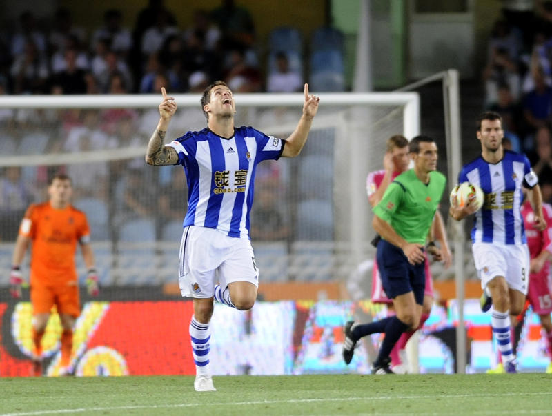 Real Sociedad's defender Inigo Martinez celebrates after scoring his team's first goal on August 31, 2014