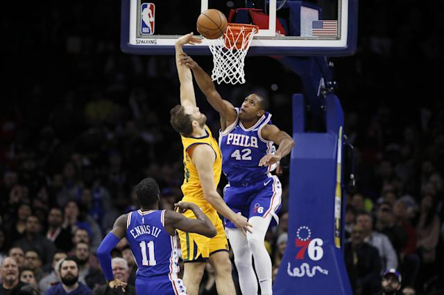 Philadelphia 76ers' Al Horford, right, blocks a shot by Utah Jazz's Bojan Bogdanovic, center, as 76ers' James Ennis III looks on during the first half of an NBA basketball game, Monday, Dec. 2, 2019, in Philadelphia. (AP Photo/Matt Slocum)