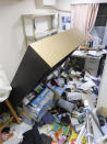 Furniture falls following an earthquake in Koriyama, Fukushima prefecture, northeastern Japan Saturday, Feb. 13, 2021. A strong earthquake hit off the coast of northeastern Japan late Saturday, shaking Fukushima, Miyagi and other areas, but there was no threat of a tsunami, officials said. (Kyodo News via AP)