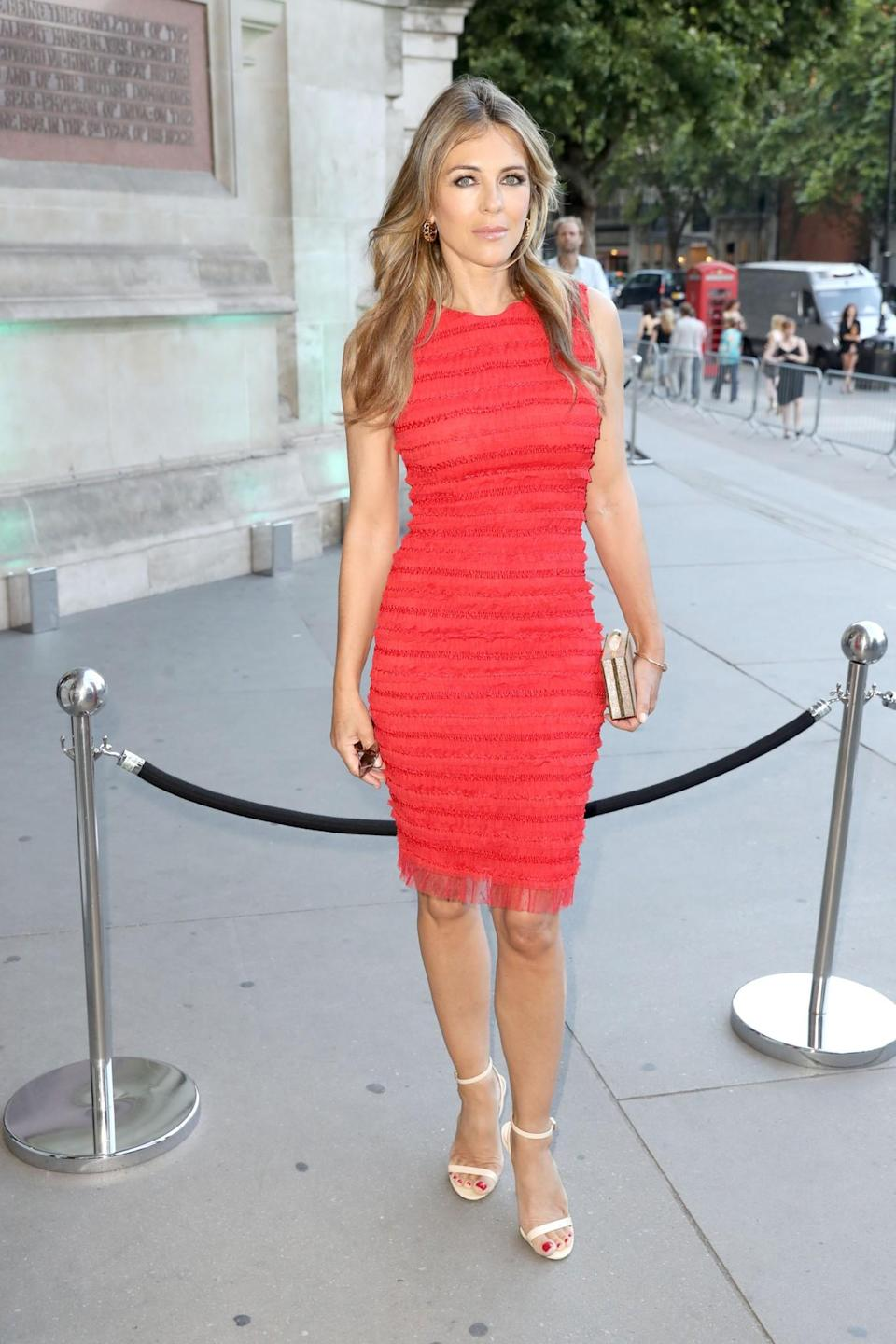 <p>The 52-year-old showed off her incredible figure in a form-fitting shift dress. <br><em>[Photo: Getty]</em> </p>