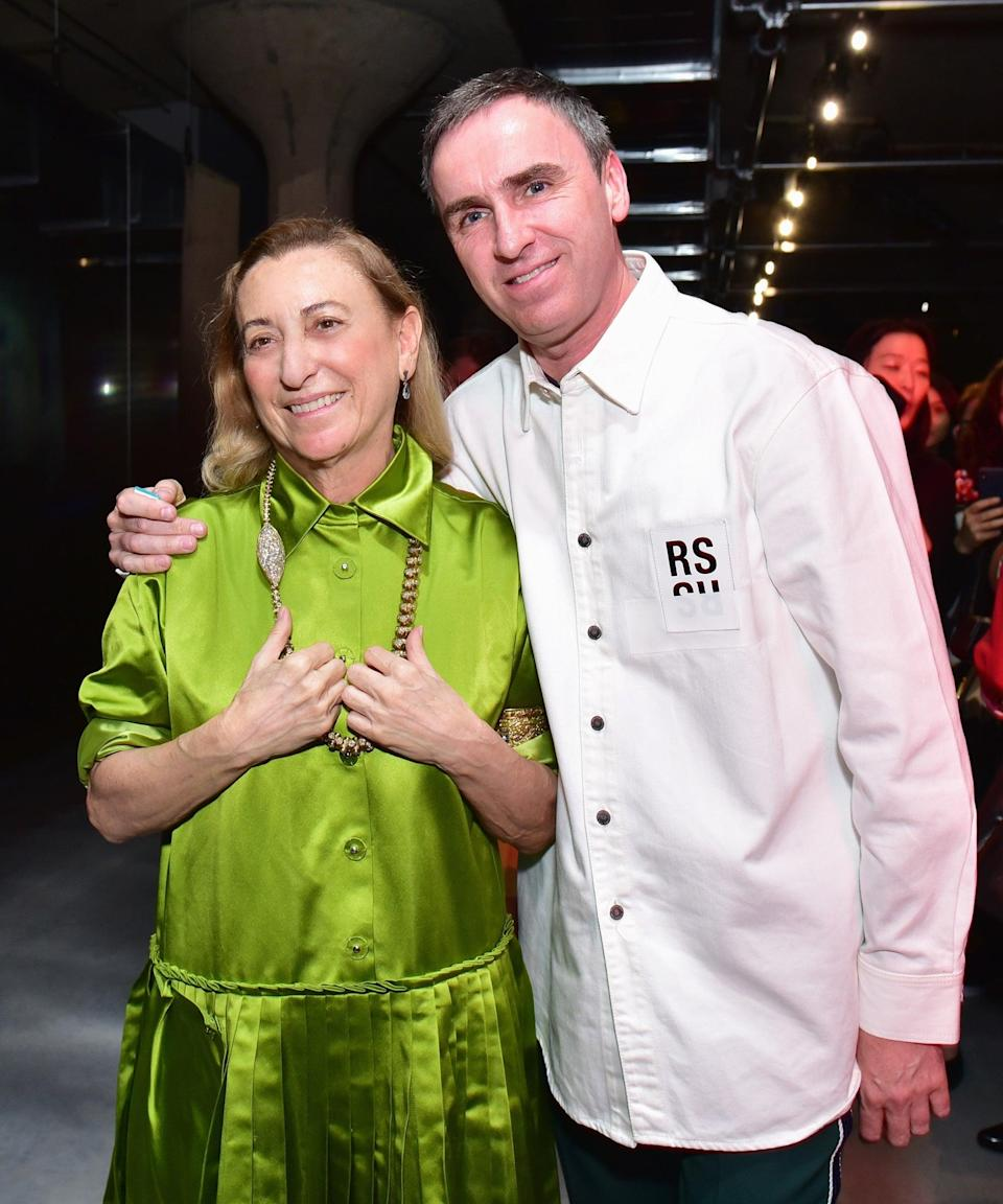 """<h2>Miuccia Prada & Raf Simons, Co-Creative Directors At Prada</h2><br>When the news broke in February that <a href=""""https://www.refinery29.com/en-us/2020/02/9457727/raf-simons-miuccia-prada-co-creative-directors-announcement"""" rel=""""nofollow noopener"""" target=""""_blank"""" data-ylk=""""slk:Raf Simons would be joining Miuccia Prada as her co-creative director at Prada"""" class=""""link rapid-noclick-resp"""">Raf Simons would be joining Miuccia Prada as her co-creative director at Prada</a>, the fashion world had high hopes — and the duo didn't disappoint. At <a href=""""https://www.refinery29.com/en-us/2020/09/10055844/spring-2021-milan-fashion-week-trends"""" rel=""""nofollow noopener"""" target=""""_blank"""" data-ylk=""""slk:Milan Fashion Week"""" class=""""link rapid-noclick-resp"""">Milan Fashion Week</a>, during their first runway show as partners, Prada and Simons put forth the best qualities of their individual aesthetics, together forming an unstoppable fashion empire. So, naturally, we want to honor their hard work this Halloween. To recreate the two designers, as they told the world in a Q&A following the show, wear a white, pleated skirt with a blue sweater for Miuccia and black trousers and a shirt (yes, that's all he said) for Raf. Easy enough. <span class=""""copyright"""">Photo: Sean Zanni/Getty Images.</span>"""