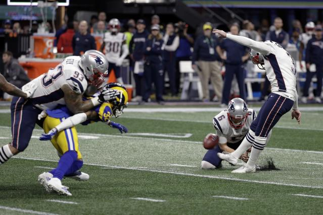 <p>New England Patriots' Stephen Gostkowski, right, misses a field goal as Ryan Allen (6) holds during the first half of the NFL Super Bowl 53 football game against the Los Angeles Rams, Sunday, Feb. 3, 2019, in Atlanta. (AP Photo/David J. Phillip) </p>