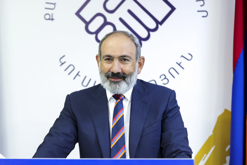 Armenian acting Prime Minister Nikol Pashinyan speaks to his party colleagues after parliamentary elections in Yerevan, Armenia, Monday, June 21, 2021. Results released Monday showed the party of Pashinyan won the snap parliamentary elections he called to ease anger over a peace deal he signed with Azerbaijan. (Tigran Mehrabyan/PAN Photo via AP)