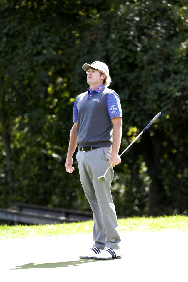 Brandt Snedeker reacts after missing a birdie putt on the seventh green during the second round of the BMW Championship golf tournament at Conway Farms Golf Club in Lake Forest, Ill., Friday, Sept. 13, 2013. (AP Photo/Charles Rex Arbogast)