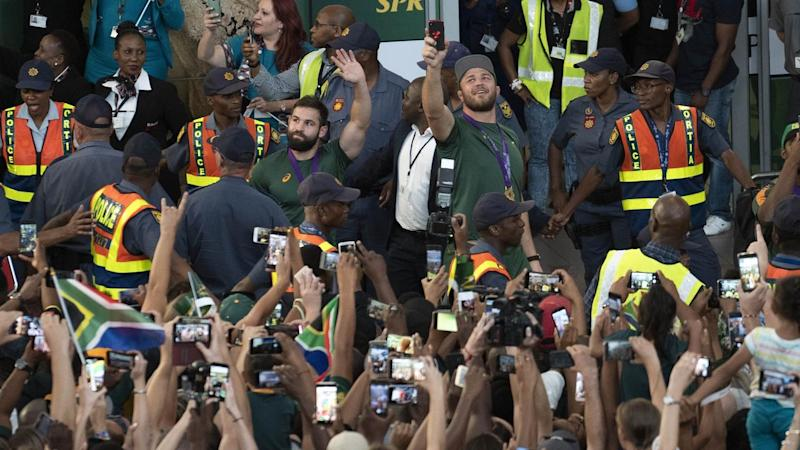 South African fans welcome their team's arrival at Johannesburg's OR Tambo airport