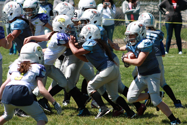 Jennasey Hargis carries the ball during a Utah Girls Tackle Football League. (Photo courtesy of Amanda Rush)