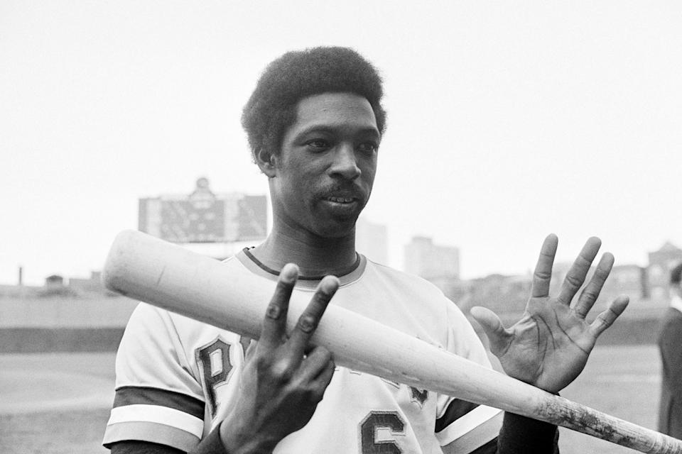 FILE - Pittsburgh Pirates' Rennie Stennett flashes seven fingers, one for each hit he made in the Pittsburgh Pirates' 22-0 win over the Chicago Cubs in Chicago, in this Tuesday, Sept. 16, 1975, file photo. Rennie Stennett has died. He was 72. The team, citing information provided by the Stennett family, said Stennett passed away early Tuesday morning, May 18, 2021, following a bout with cancer. (AP Photo/Charles E. Knoblock, File)